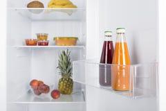 Open fridge full of fresh fruits and vegetables Stock Image