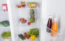 Open fridge full of fresh fruits and vegetables Stock Photo