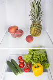 Open fridge full of fresh fruits and vegetables Royalty Free Stock Photography
