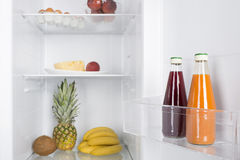 Open fridge full of fresh fruits and vegetables Royalty Free Stock Images