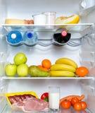 Open fridge full of fruits stock photos