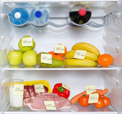 Open fridge full of fruits Stock Photo