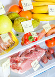 Open fridge full of fruits, vegetables and meat Royalty Free Stock Photo