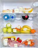 Open fridge full of fruits, vegetables and meat Stock Photo