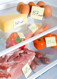 Open fridge full of vegetables and meat Royalty Free Stock Photography