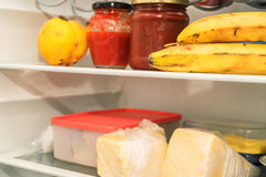 Open fridge with usual food Royalty Free Stock Photography