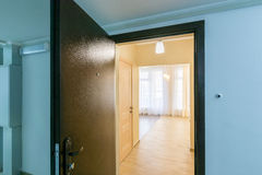 The open front door in renovated apartment new building Stock Image
