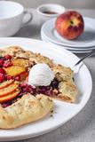Open fruit pie. Galette with peach and raspberries. Open fruit pie royalty free stock photos