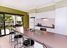 Open Galley-Style Kitchen. An open plan galley-style modern kitchen Royalty Free Stock Photos
