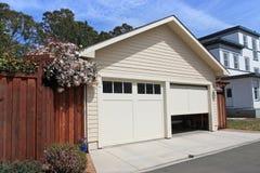Open Garage Door. In suburban house royalty free stock images