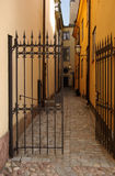 Open Gate. Open iron gate leading to a narrow street in Stockholm, Sweden stock photography