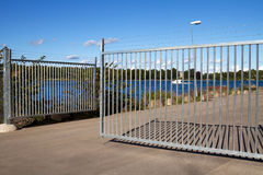 Open gate. Security gate with barbed wire royalty free stock photos