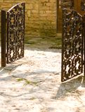 Open gate. Open antique cast iron gate Stock Photos