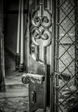 An Open Gate. A black and white open metal gate Royalty Free Stock Photography