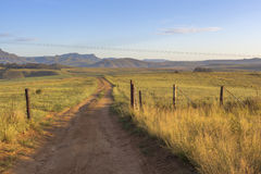 Open gate and farm road. South Africa royalty free stock photo
