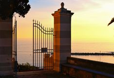 Open gate in front of old church in village in Sestri Levante in Liguria, Italy royalty free stock photography