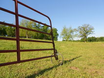 Open Farm Gate with Wheel and Rural Landscape Royalty Free Stock Photos