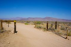 Open Gate Leads into Desert Stock Photo