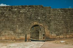 Open gate on a stone outer wall stock photos