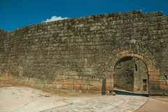 Open gate on a stone outer wall. Open gate arch on a stone outer wall in a sunny day, at the historic city center of Sortelha. One of the most astonishing and royalty free stock images