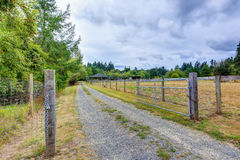 Open gate to a horse farm in the countryside stock image