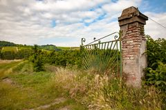 Open orchard gate. An open gate to an orchard in Volpedo, Piedmont, Italy royalty free stock photos