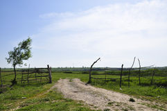 The open gate. Wooden fence on a fields, countryside in Dobrogea, Romania Royalty Free Stock Photo