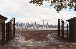 Open Gates. View of new york skyline through open gates of hamilton park in weehawken, nj Royalty Free Stock Photo