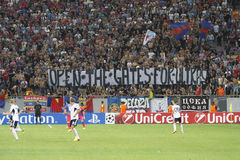 Open the gates for ultras. Banner of Steauas fans revealed during the UEFA Champions League play offs game between Steaua Bucharest (Romania) and Legia Warsaw Royalty Free Stock Photography