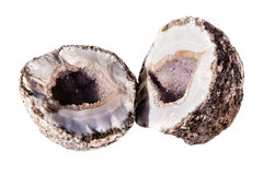 Open geode. An open amethyst geode isolated over a white background Stock Photos