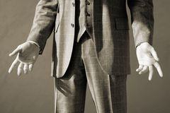 Open gesture, greyscale. Businessman in suit making gesture with arms, greyscale Royalty Free Stock Images