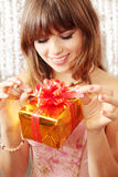 Open the gift. Is happy girl it reveals the gift Royalty Free Stock Photo