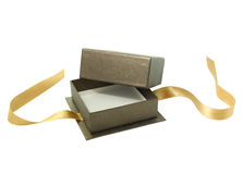 Open gift box. With the golden ribbon. Isolated. White background royalty free stock image