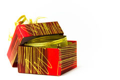 Open gift box. Red open gift box on white background with golden bow Royalty Free Stock Photo