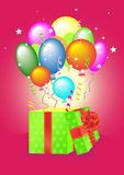 Open gift box with balls Royalty Free Stock Image