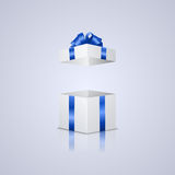 Open gift box. Beautiful realistic open gift box with blue ribbon and bow Royalty Free Stock Photo