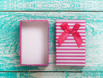 Open gift box on blue vintage wooden desk top view. Stock Images