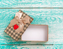 Open gift box on blue vintage wooden desk top view. Royalty Free Stock Images