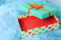 Open gift box with bow and red ribbon Royalty Free Stock Photos