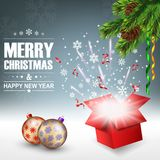 Open gift box with bright light and confetti, christmas background Stock Photo