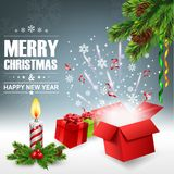 Open gift box with bright light and confetti, christmas background Stock Photography