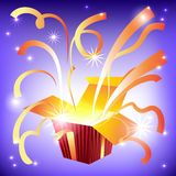 Open gift box with bright rays of light and flying. Ribbon Royalty Free Stock Image