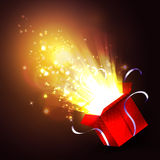 Open gift box with bright rays of light Stock Photos