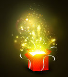 Open gift box with bright rays of light Stock Photography