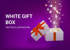 Open gift box with bright rays of light Stock Images