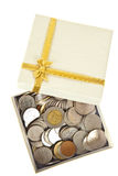 Open gift box, contains many coins Royalty Free Stock Photography