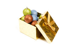 Open gift box filled with christmasballs. Isolated on a white background royalty free stock images