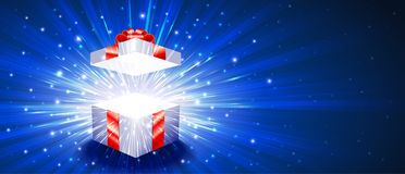 Open Gift Box Firework Explosion Magic Light Radiant Background. Greeting package with red bow knot. Open gift box with exploding firework of glitters and light Stock Images