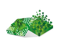 Open the gift box with the flying out clover three-leaf inside. Stock Photos
