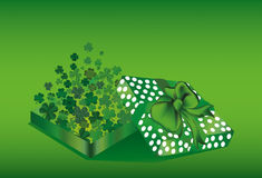 Open the gift box with the flying out clover three-leaf inside. Stock Images